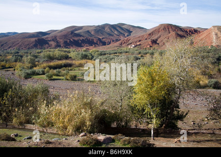 Morocco North Africa December Looking across a valley in  foothills of High Atlas Mountains towards mud huts of - Stock Photo