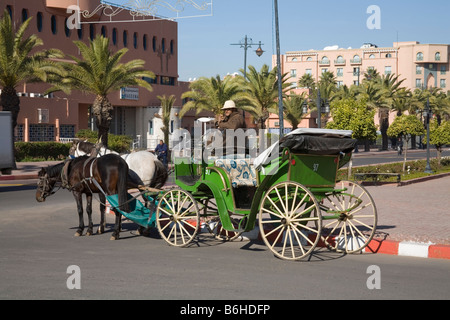 Marrakech Morocco North Africa December The driver of a caleche stopped to have a cigarette - Stock Photo