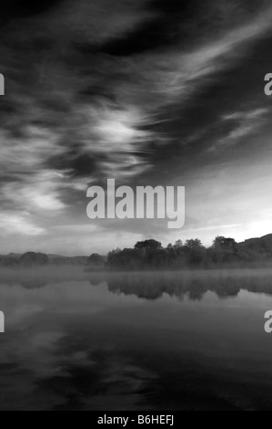 Misty morning at Esthwaite water located between Near Sawrey and Hawkshead in the English Lake District. - Stock Photo