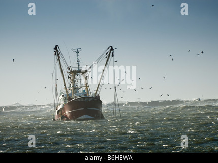fishing ship in a storm ijmuiden Holland the Netherlands - Stock Photo