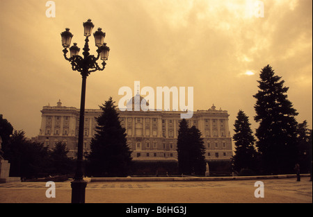 Royal Palace and street lamp in winter, seen from Sabatini Gardens, Madrid, Spain - Stock Photo