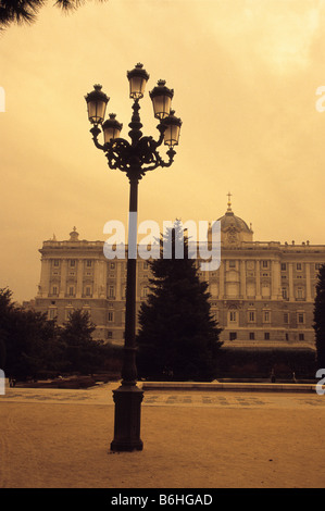 Royal Palace and street lamp, seen from Sabatini Gardens, Madrid, Spain - Stock Photo