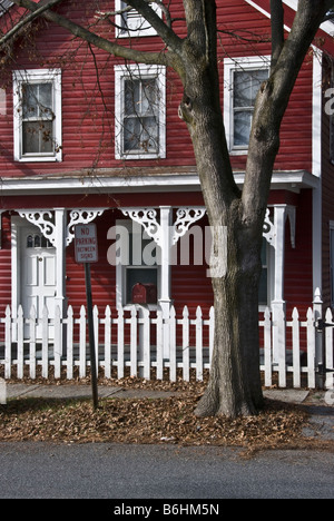 Small Simple White Clapboard Victorian Style House With