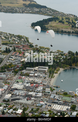 Two paragliders over Queenstown as viewed from Bobs Peak - Stock Photo