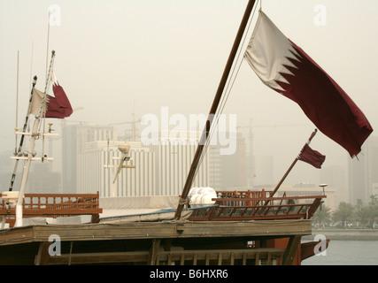 Qatari flags decorating traditional boats at Doha Bay, Qatar - Stock Photo