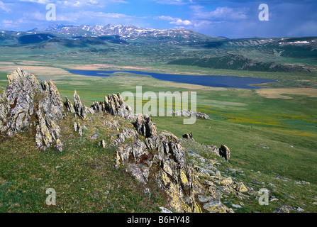 A valley and the Black Lake in Kanas national park in Xinjiang, China. - Stock Photo
