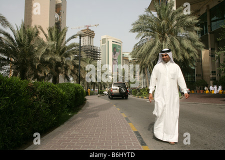 A Qatari man in traditional attire on the street of Doha, Qatar. - Stock Photo
