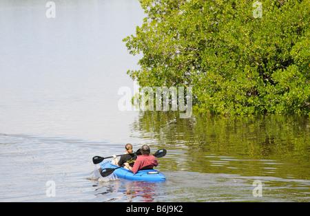 J N Ding Darling National Wildlife Refuge man and woman kayaking on Tarpon Bay Sanibel Island Florida USA - Stock Photo