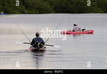 J N Ding Darling National Wildlife Refuge man and woman kayak fishing off Sanibel Island Florida USA - Stock Photo