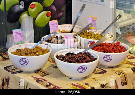 Olives on sale in farm shop - Stock Photo