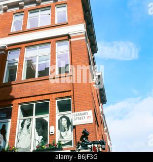 Carnaby Street sign on corner building Soho London England UK - Stock Photo