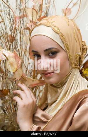 Beautiful young Muslim woman wearing Hijab - Stock Photo