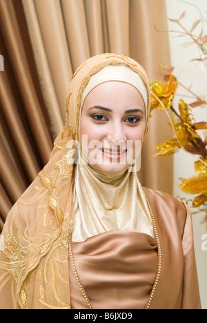 Portrait of a beautiful young Muslim woman wearing Hijab - Stock Photo