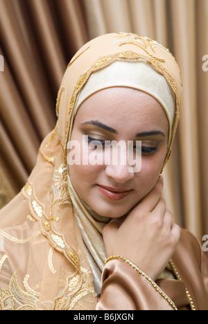 Beautiful Muslim girl wearing Hijab - Stock Photo