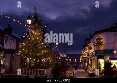 UK England Cheshire Stockport Marple Christmas tree and local shops at night - Stock Photo