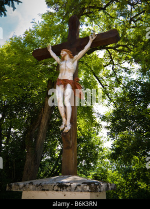 Large statue of Jesus Christ on the cross outside a church in southwest France Europe
