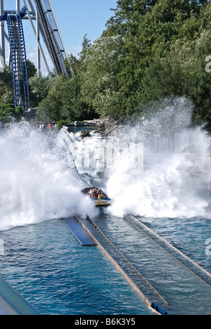 A boat plows over the rapids of the Poseidon roller coaster at Europa Park, Rust, Germany - Stock Photo