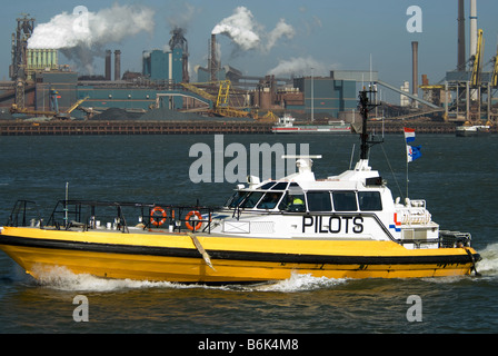a pilot ship in the harbor of IJmuiden in the Netherlands - Stock Photo
