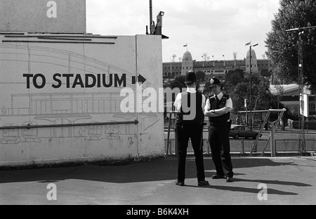 Policeman on patrol outside Wembley Stadium before the 1999 FA Cup Final, London. - Stock Photo