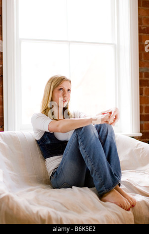 Portrait of teen sat on Sofa - Stock Photo