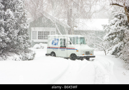 A US Postal Service truck is stuck in 'lake-effect' snow from Lake Michigan after delivering mail to a residence - Stock Photo