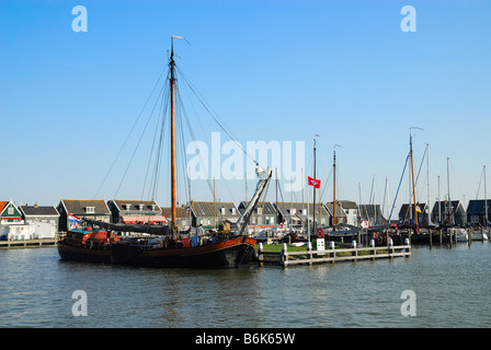 old dutch houses and boats in Marken a small village near Amsterdam - Stock Photo