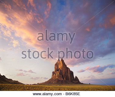 Shiprock 1100 foot high volcanic monolith or Rock with Wings as some Navajo Indians call it Navajo Indian Reservation - Stock Photo