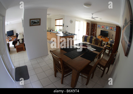 FISHEYE VIEW OF INTERIOR OF HOUSE INCUDING LOUNGE DINING AND FAMILY ROOMS - Stock Photo