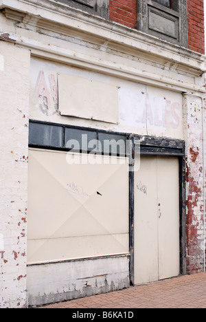 Abandoned business premises in an area suffering urban decay - Stock Photo