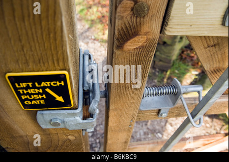 Latch on a wooden two way opening gate - Stock Photo