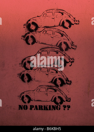 VW Beetle x 5.Poster print on a wall, no parking. Problem with parking, multi story parking on-top of each other. - Stock Photo