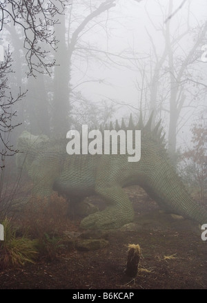 Dinosaur in the mist in Crystal Palace Park - Stock Photo