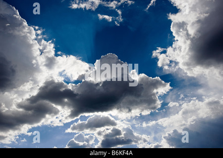 Dramatic clouds in blue sky - Stock Photo