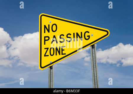 no passing zone traffic sign in nature stock photo, royalty free