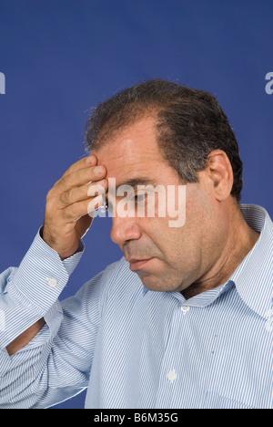 Man head in hand - Stock Photo