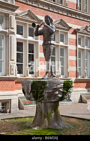 Pied Piper of Hamelin statue on fountain in town of Hamelin Germany - Stock Photo