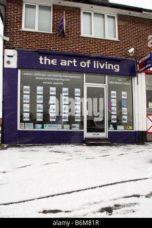 Snow Outside a Parade of Local Shops in A Hampshire Village - Stock Photo