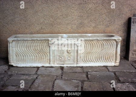 Marble sarcophagus outside museum at Roman Timgad Algeria North Africa A UNESCO World Heritage Centre Timgad lies - Stock Photo