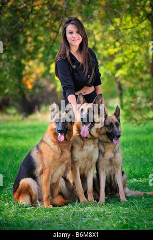 Teenage girl with three dogs - Stock Photo