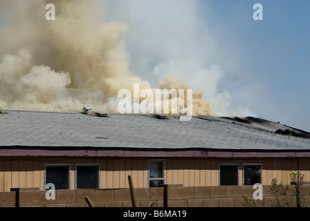 house on fire in a residential area - Stock Photo