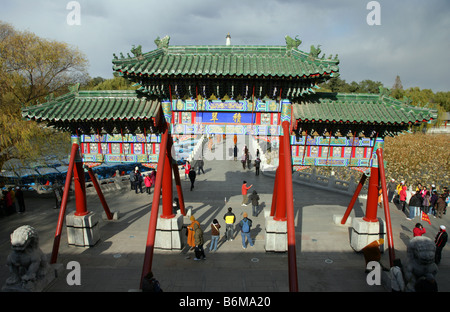 Beihai Park Beijing showing the gateway and bridge to the Jade Flowery Islet Beijing China - Stock Photo
