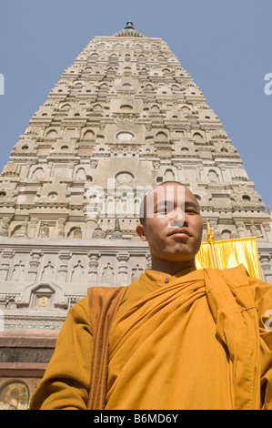 Monk in front of a temple, Mahabodhi Temple, Bodhgaya, Gaya, Bihar, India - Stock Photo