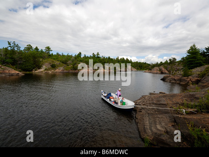 Boating in the Pickerel river, near the French River, Northern Ontario, Canada - Stock Photo