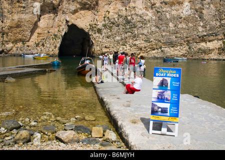 Tourists visiting the Inland Sea, Il-Qawra, Dwejra, Gozo, Malta - Stock Photo