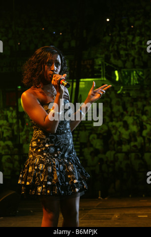 Alexandra Burke pop singer X Factor 2008 winner. Singing during Young Voices Concert Hallamfm  2006 Vertical 64194 - Stock Photo