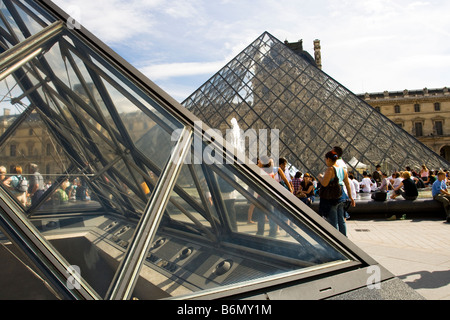 A detail shot of the glass pyramids at the Musee du Louvre in Paris, France - Stock Photo