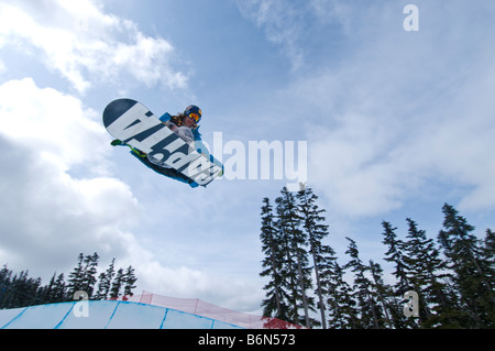Athlete competing at the Telus World Ski and Snowboard Festival in Whistler, Canada held every April - Stock Photo