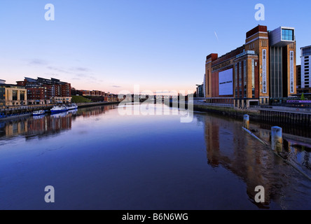 View looking east on river Tyne from Millennium Bridge towards Newcastle Quayside and  Baltic Centre for Contemporary - Stock Photo