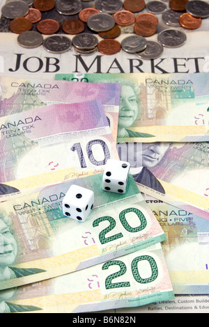 Dollar bills, coins, and dice laying on newspaper with the words 'Job Market' visible, symbolizing today's economy - Stock Photo