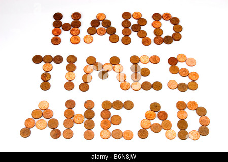 Concept of words 'Hard Times Ahead' spelled out in pennies on white background symbolizing lean times - Stock Photo